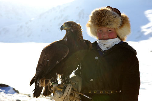 Training her eagle to hunt