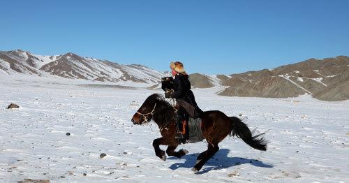 Part of eagle hunting is on horseback