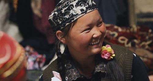 Happy eagle huntress at a festival