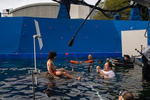 Neel as Mowgli working on set with director Jon Favreau