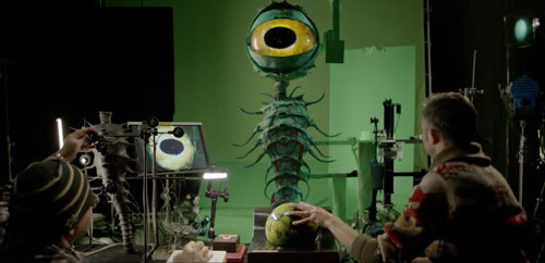 Stop-Motion animators working with giant eye puppet