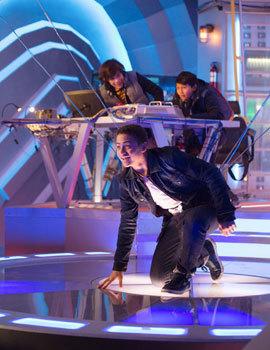 Ryan kneels to make the robot kneel