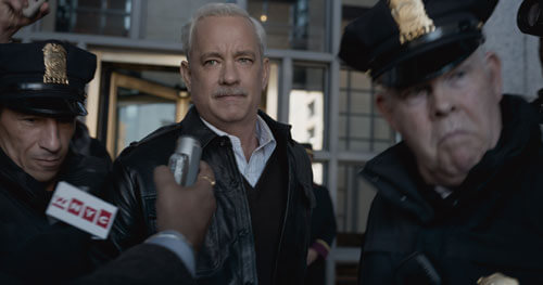 An exhausted Sully is questioned by press