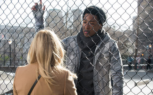 Time (Jacob Latimore) talks with Claire (Kate Winslet)