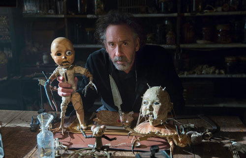 Director Tim Burton with some of the film's weird toys