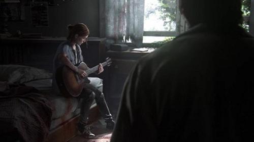 Joel listens to Ellie's guitar.