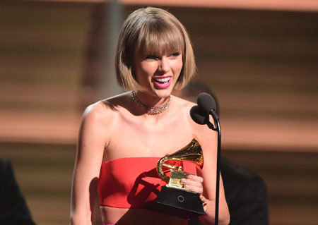 Taylor Swift accepting the Album of the Year Award