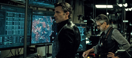 Bruce Wayne with Alfred in the batcave
