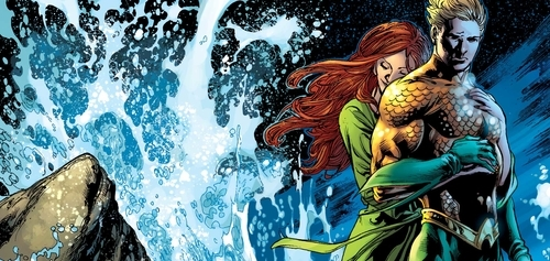 Aquaman stands with his love interest Mera.