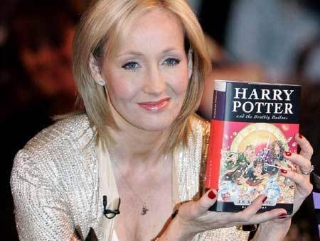 J.K. RowJ.K. Rowling with Harry Potter and the Deathly Hallows bookling with a Harry Potter Book