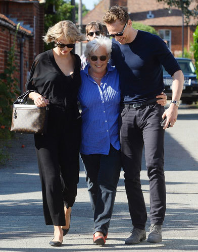 Taylor has already met Tom's mother - seen here arm-in-arm