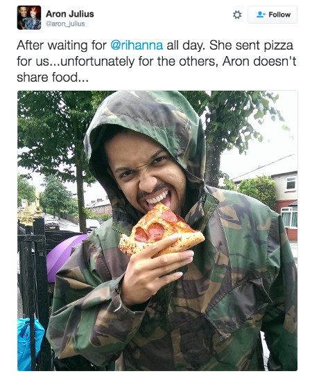 A fan digs into his free pizza