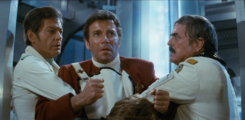 McCoy and Scotty prevent Kirk from going to Spock's aid