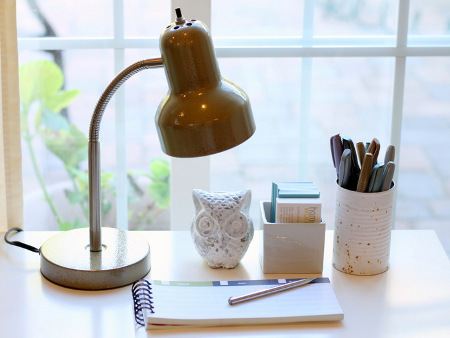 A tidy desk with a lamp will make your study space bright and welcoming