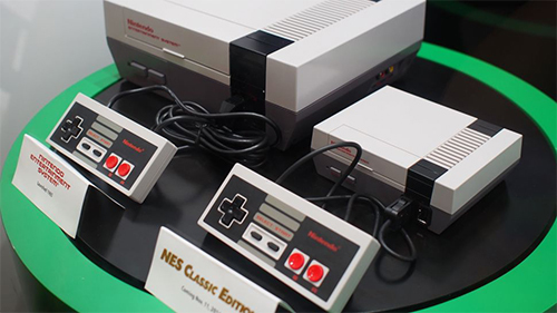The smaller NES Classic next to it's original inspiration.