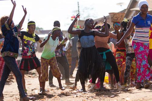 Fiona (Madina) dances with friends