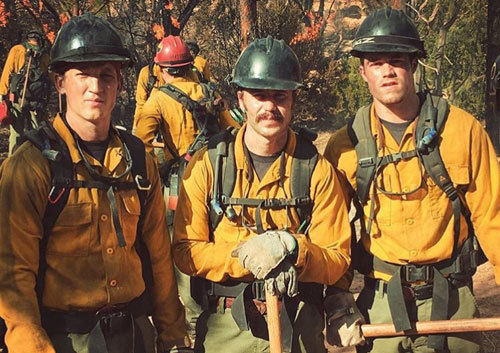 Miles and Taylor on set with another firefighter actor