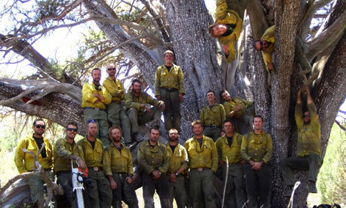 The real-life Granite Mountain Hotshot crew in front of the Juniper