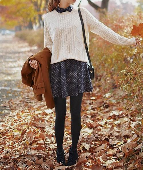 A light spring dress finds new life in fall with tights and a sweater