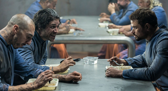 Sy (Kellan Lutz, right) and prisoners plan the break out