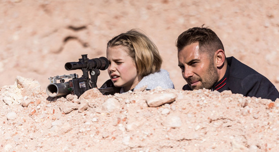 Indi's dad Kane (Dan MacPherson) teaches her how to shoot