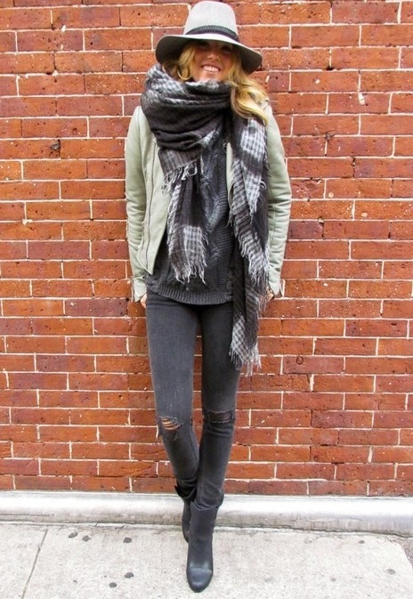 Balance lots of layers on top with narrow boots and slim jeans on the bottom
