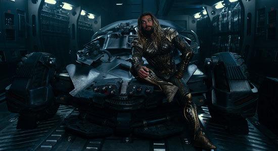Aquaman gets comfy on the Batmobile