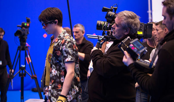 Director Luc Besson shoots Dane DeHaan in a scene