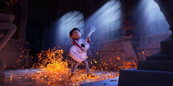 Miguel strums Ernesto's guitar and a strange magic happens