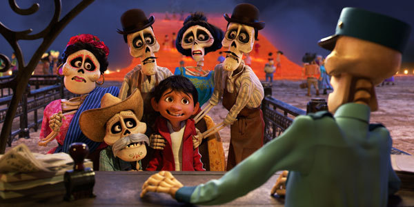 Miguel, with his dead family members, is discovered