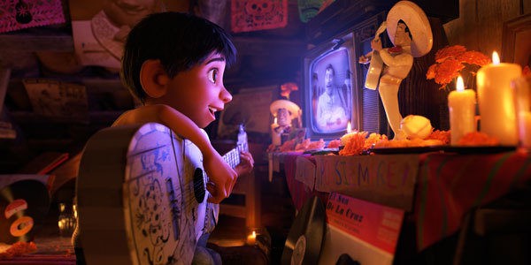 Miguel learns to sing and play by watching old Ernesto video tapes