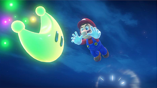 Mario dives for one of the Sand Kingdom's Power Moons.