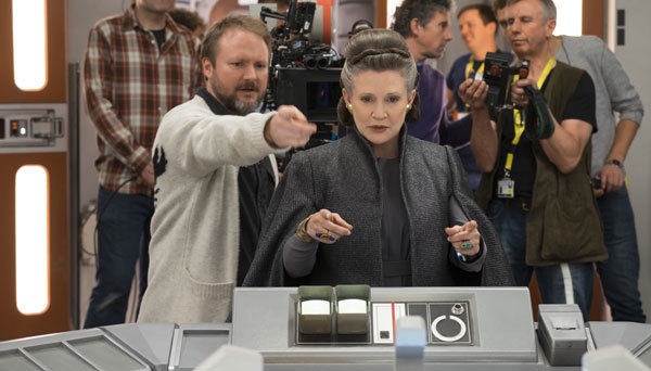 Carrie takes direction on set