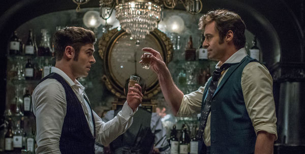 Barnum (Hugh Jackman) and Phillip (Zac Efron) make a deal