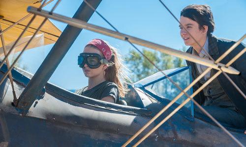 Tulsa helps Gardner escape in a crop duster plane