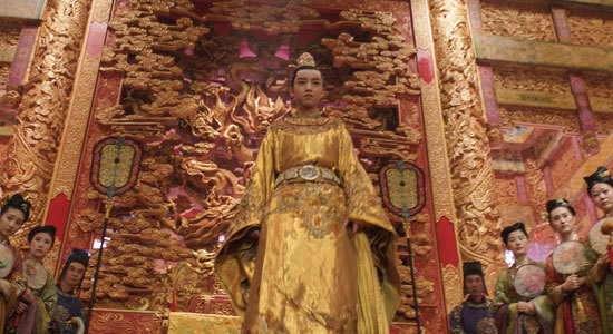 The young Emperor (Junkai Wong) receives the scary Taotie monster