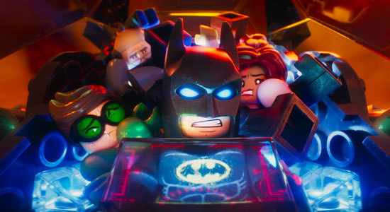 The gang is crowded into the Batmobile