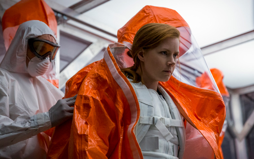 Louise (Amy Adams) suits up to talk to the aliens