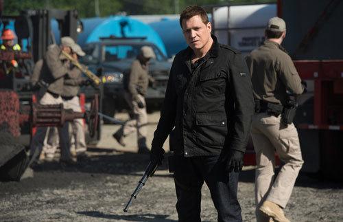 Mercenary Burke who is hired to kill Creech
