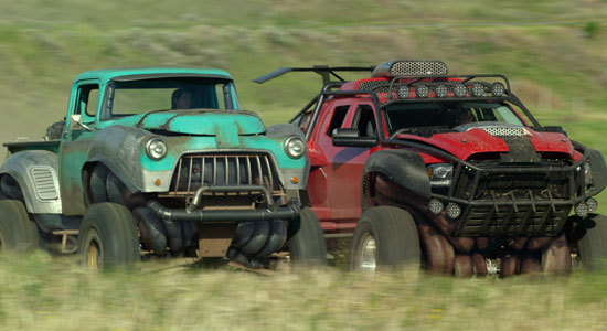 Two of the Monster Trucks in action