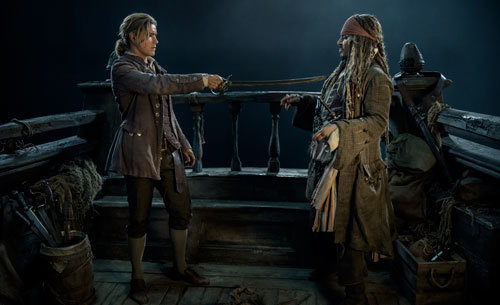 Henry (Brenton) holds Jack Sparrow at swordpoint