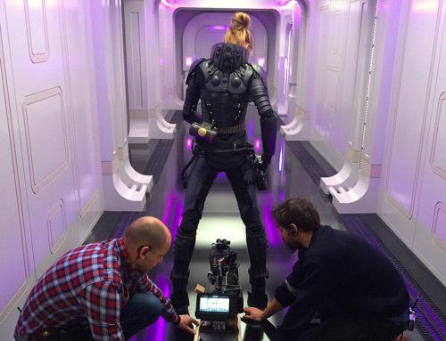 The crew prepares Cara for a scene