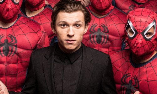 Tom Holland surrounded by Spider fans
