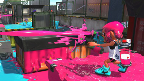 An inkling fires their Splat Dualies, one of the most popular weapons.