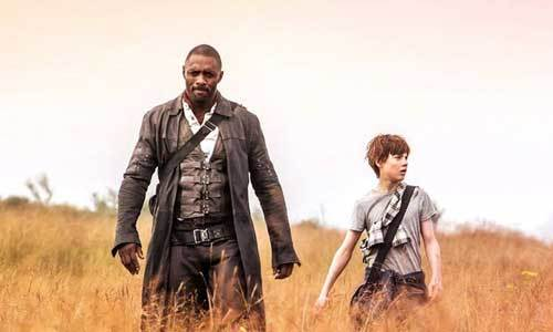 Idris Elba as Gunslinger with the young boy he protects