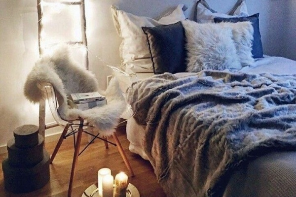 Faux fur, faux candles, and twinkly lights create a cozy, dreamy space