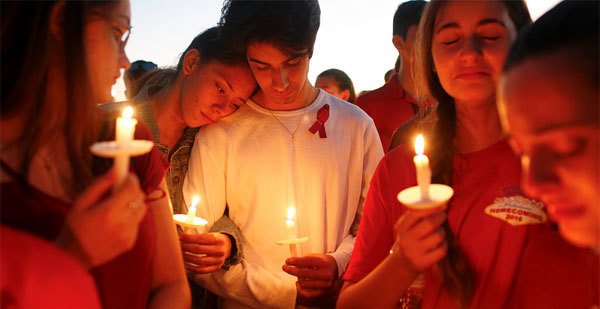 Students attend a candlelight vigil for victims of the mass shooting at Marjory Stoneman Douglas High School in Parkland, Florida.