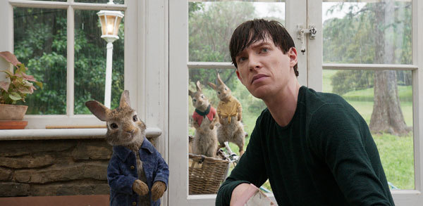 Thomas pretends to tolerate the bunnies