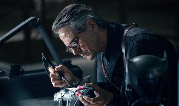 Alfred works on Batman's equipment