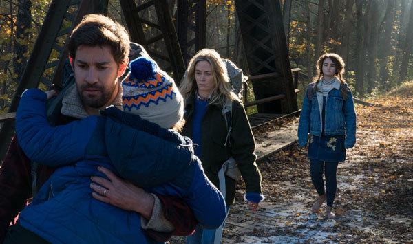 The barefoot family treks silently home